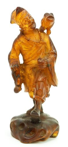 19 - 18th/19th C CHINESE CARVED GOLDEN AMBER LU HAI Antique Chinese hand carved golden amber sculpture depicting a standing Lu Hai holding ...