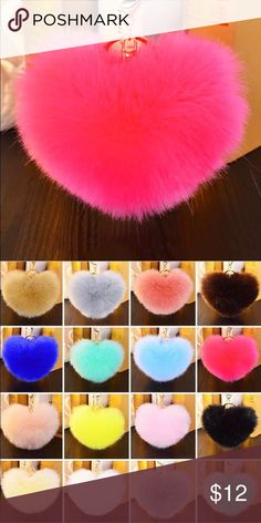 Heart Shaped Fur Ball Keychain Get the look!! PINK heart shaped Fur Ball Keychain  Made with faux fur  Soft and Luxurious  Watermelon PINK heart for ball A fabulous way to accesorize!! Also available in light pink and dark blue! Accessories