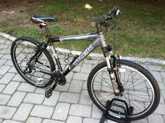this is not mine but i have one like it,thanks-Trek 4500 mans mountain bicycle mens gray aluminum trail bike Rock Shox fork…