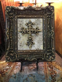 Decorative frame mounted with cross accented with gold highlights and hand embellished with Swarovski crystals. Frame can be displayed in stand or wall mounted. Measures apprx 17 tall x 14 wide. Handmade in the USA. Light Wooden Floor, Tuscan Furniture, Cross Pictures, Gallon Of Paint, Cross Art, Tuscan Design, Mediterranean Home Decor, Gold Highlights, Tuscan Decorating