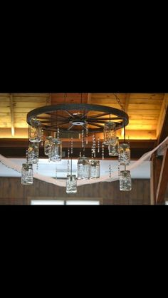wagon wheel chandelier alternating length wagon wheel mason jar