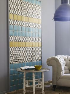 Tile wall... great DIY idea using remnant tile or splurging on a small amount of expensive tile. Even better, mount it to a frame for easy removal for future remodels.