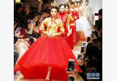 Models present Guo Pei's creations at Shanghai fashion week 04/2015 Chinadaily.com.cn