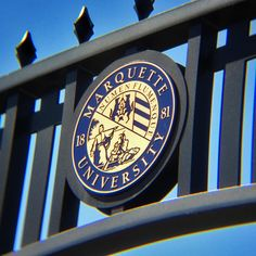 Marquette University seal on the archway to the Alumni Memorial Union.