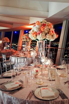 Tall centerpiece with peach, orange, and coral hues. Floral Design by JMorganflowers.com