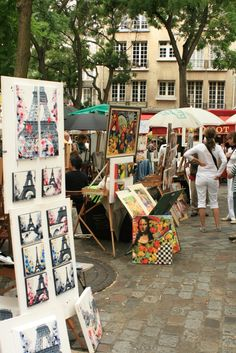 Montmartre, Paris, France and you can have a drawing done here as well ! Get one of your kids!
