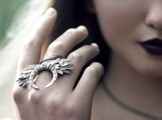 Ritual ring - An intriguing ring of feathers, moons, and runes.