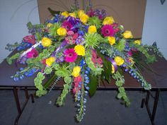 Casket Spray  Made with assorted flowers