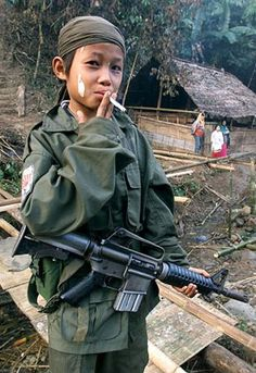 Children robbed of childhood. This picture broke my heart. There shouldn't be ant child soldiers at all. STOP ALL WARS!!!!!