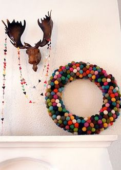 Pompom Wreath by aubreeze: This would be easy to do by wrapping a pompom garland around a foam circle. #pompom_Wreath #DIY #aubreeze