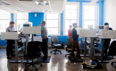 Standing height desks to work on data-driven medicine at Mount Sinai School of Medicine.