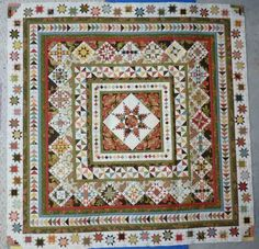 """Sue Garman's """"Stars for a New Day"""" pattern. Custom Quilting that is a wow"""