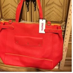 ⚡️Sale ⚡️. Trendy orange/red and yellow purse. NWT. This large purse boasts lot of room and style. It has an orange-y red color with yellow accents. Magnetic top closure. Has optional shoulder strap. Inside is one large opening. No zippers or pockets. Beautiful. JustFab Bags Totes