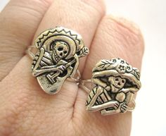 Mexican Sugar Skull Jewelry Silver Two Finger Rings Day of the Dead. $21.95, via Etsy.