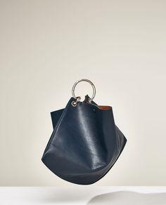 STUDIO LEATHER BUCKET BAG WITH HOOPS