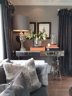 The desk, lamp and art combo would look great in a foyer. Neutral grays.