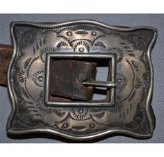 NAVAJO CONCHO BELT--great close-up of a square buckle, a shape, native silversmiths have told me, that was inspired by the wrist guard used with a bow.