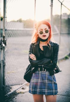 Le Happy wearing creepers with a plaid skirt and Elizabeth and James leather jacket