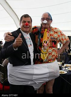 "Quito, Ecuador. 10th Feb, 2014. Ecuador's President Rafael Correa (L) poses with US doctor Hunter Doherty ""Patch"" Adams during a lunch with youth organizations in Qmanda park. © Santiago Armas/Xinhua/Alamy Live News"
