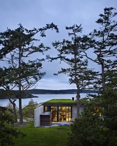 Olson Kundig Architects created a camouflaged concrete house called 'The Pierre' in San Juan Islands, Washington. The owner's affection for a stone outcropping on her property inspired the design of this house. Conceived as a retreat nestled into the rock, the Pierre (the French word for stone) celebrates the materiality of the site.
