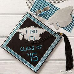Your mortarboard is your canvas! Make your cap POP with shimmery duct tape, bright stick-on rhinestones and a graduation themed cutout.
