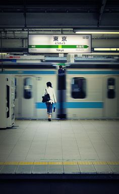 Tokyo trains - Perfect Timing. Do you see ... a man in between gap of the train? And also, I think Japanese Trains run in perfect timing as well.