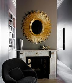 An otherwise dull room made exciting with a bold gold mirror.