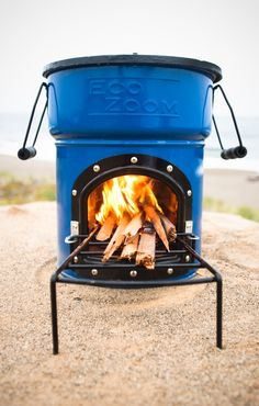 EcoZoom's Zoom Dura Rocket Stove _ Burns wood and other dry solid biomass. The Dura is great for camping. It features an abrasion resistant & durable ceramic combustion chamber with a 10 cm in diameter vertical section that forces the gases to mix with the flame, decreasing harmful emissions. The Zoom Dura adds a refractory metal liner to the inside of the combustion chamber that protects the ceramic insulation, increases the life of your stove, & improves combustion efficiency.   EcoZoom