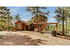 You can come home to awesome MOUNTAIN VIEWS on 5 PRIVATE ACRES! This lovely home with PANORAMIC SNOW CAP VIEWS is just minutes from metro DENVER. You'll enjoy the HOT TUB, extensive DECKING and PERGOLA in the tranquil mountain setting. The open floor plan with a cozy wood stove and spacious kitchen opens to the deck where you will see THE most spectacular SUNSETS! The spacious master suite with a great walk in closet has the best view in the home and the heated tile floors in the baths are a…