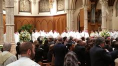 Bishops filling the sanctuary. 9 cardinals, 58 arch/bishops & papal nuncio came to pay respects to Cardinal George