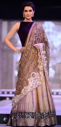 Kriti Sanon displays a gorgeous designer lehenga at a fashion event. Source: Rediff.com