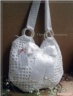 Pretty white granny square bag with a bow. Simple work and several granny diagrams are provided to choose one or all to remake.