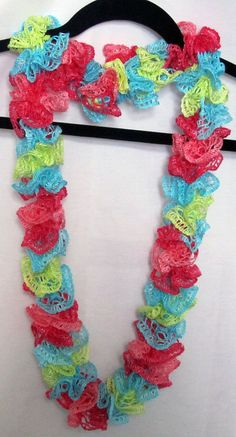 Girls blue, lime green, lt.pink and dk pink scarf hand knitted with a mini frill yarn that makes kid-size ruffles for your favorite girl. #handmade #gifts