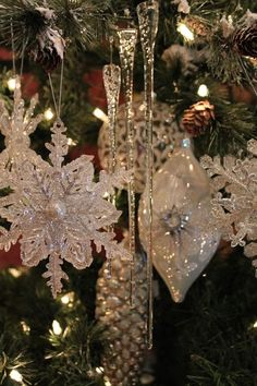 GLASS ICICLES...  Christmas trees transform with brilliant sparkle and shine as these crystal clear Department 56 glass icicles of assorted lengths are placed on your tree. (Set of 24) | www.exclusivelychristmas.com