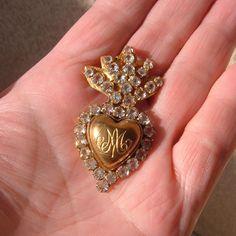 Tiny Antique Ave Maria Brass Rhinestone Flaming Sacred Heart Ex Voto Reliquary by MetalCorsetII on Etsy https://www.etsy.com/listing/259985258/tiny-antique-ave-maria-brass-rhinestone