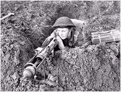 Private Edmund Arsenault of The West Nova Scotia Regiment aiming a PIAT anti-tank weapon from a slit trench near Ortona, Italy, 10 January Canadian Soldiers, Canadian Army, Canadian History, British Army, Ww2 Pictures, Military Pictures, Ww2 Photos, Nova Scotia, Airborne Army