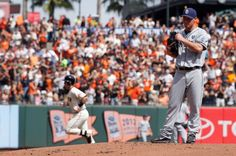 San Diego Padres starting pitcher Robbie Erlin, right, stands on the mound as San Francisco Giants' Buster Posey, left, rounds the bases after hitting a two-run home run during the first inning of a baseball game in San Francisco, Sunday, Sept. 28, 2014. (AP Photo/Tony Avelar)