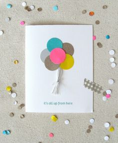 Cute birthday card idea: put colorful paper circles together as balloons and glue them onto paper along with some string.