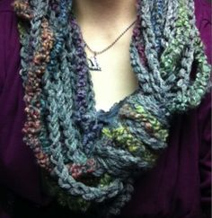 An awesome cowl/scarfy thing to crochet. (Looks simple, actually, just a chain stitch.)