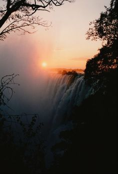 """Victoria Falls - Also called Mosi-oa-Tunya (National Park in Africa) (meaning """"smoke that thunders."""" Largest waterfall based on width and height One mile wide km) and 360 feet high meters) Two national parks protect the falls. Beautiful Sunset, Beautiful World, Beautiful Places, Beautiful Pictures, Beautiful Waterfalls, Landscape Photography, Nature Photography, Chobe National Park, National Parks"""