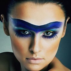 I love this, the white line to accentuate the blue, the under lashes, I just wish thye had conditioned her lips! Avant-garde Eye Makeup with Blue Eyeshadow and Lashes