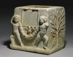 A ROMAN MARBLE CINERARY URN OF BAEBIA SATYRA AND M. CATONIUS THREPTUS, CIRCA LATE 1ST CENTURY A.D.
