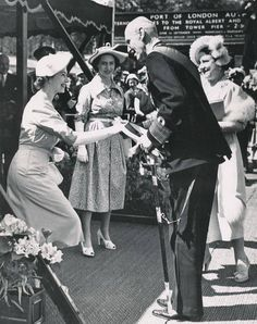 A very rare sight to see! HRH Princess Elizabeth, currently HM Queen Elizabeth II curtsying to her Great Uncle by marriage, King Haakon of Norway circa 1950