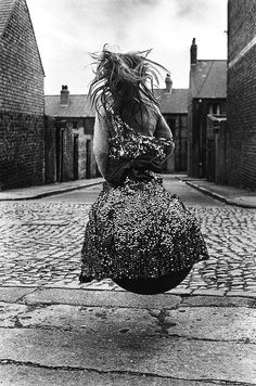 girl on a spacehopper, byker, newcastle, england, 1971 photo by sirkka-liisa konttinen, from the photography book