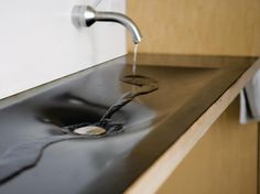 Most recycled rubber is trod underfoot — it's used for flooring, as a playground or athletic field mulch, and some companies use recycled rubber in the soles of their shoes. But this elegant RUBBiSH sink uses a flexible sheet of recycled rubber to form a lightweight, waterproof surface for a shallow sink.