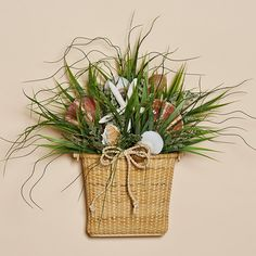 This 16 inch high Shell & Grass Nantucket style wall basket with handle is a magical reminder of Cape Cod. Basket measures 7 inches and is filled with forever native grasses and a stunning assortment