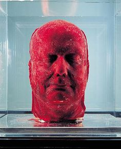 This is a sculpture (or mold) of artist Marc Quinn's head made from 4.5 liters of his own frozen blood. The blood is taken from this body over a period of five months. The work is then repeated every five years to establish a unique record of the artist aging.