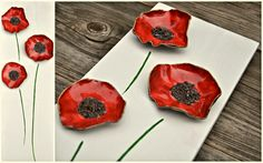 Make flowers out of clay and put them on a canvas :) :) beautifully