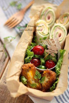 行楽用くるくるロールサンドイッチのお弁当♪  ・くるくるラップロールサンド(ハム、チーズ、レタス)  ・クリームチーズとかぼちゃのコロッケ  ・プチトマトとキュウリのごま塩和え       ~女の子のお弁当~ 毎日がお弁当日和♪