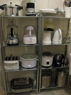 """I so """"NEED"""" these shelves in my kitchen for all my small appliances.Organize small appliances on open shelving units - would be great to put in the pantry to reduce the look of clutter around the kitchen. Steel shelves are from Ikea. Ikea Kitchen Shelves, Ikea Shelves, Kitchen Decor, Kitchen Cabinets, Storage Shelves, Garage Cabinets, Diy Cabinets, Pantry Shelving, Wooden Shelves"""